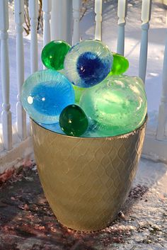 If you want to add color to a winter garden, try this easy craft project that even kids can do. The spheres are made with water balloons and food coloring. While it's a simple project, there are several tips in the article that can save you from having a slushy mess.