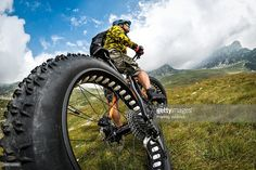 Low angle view of male cyclist with his fat bike while exploring new off-road areas and beautiful panoramic nature in the mountains. Wide Angle Photography, Bike Photography, Perspective Photography, Photography Lessons, Creative Photography, Portrait Photography, Gopro, Photo Composition, Low Angle