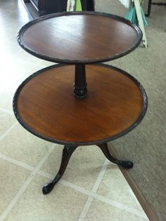 Beautiful Vintage Mahogany 2 Tiered Round Pie Crust Table circa 1940. $295.00, via Etsy.