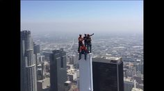 Workers atop the tallest building west of the Mississippi river. Wilshire Grand Tower in Los Angeles.