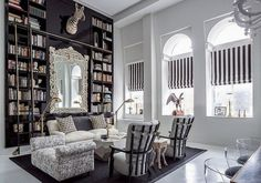 Luxurious Home Library in White Wall and Big Black Cabinet as Bookshelves