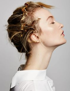 Adir's original concept, a head full of gilded feathers. We set out to remake an organically shaped quill into a multifaceted metallic sculpture for the hair. Style this headband on the top of your head or at the nape of your neck.Each halo is uniquely crafted, no two are the same. Handmade in NYC.