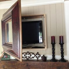 DIY mirror box to hide mounted tv! (did the same to hide an inside fuse box) DIY mirror box to hide mounted tv! (did the same to hide an inside fuse box) Mirror Tv, Diy Mirror, Tv Escondida, Tv Wanddekor, Tv Wall Cabinets, Tv Covers, Tv Wall Decor, Wall Tv, Hidden Tv