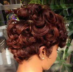 chestnut brown short curly hairstyle