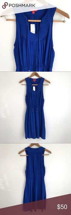 """Elle """"Must Have Dress"""" in Blue NWT Royal blue Elle """"Must Have Dress"""" purchased from Kohl's. Very flattering fit! Two sets of ties in the front with silver toned beads at the end - tie them or leave them open. Elastic waist. Size M. Approx. 19"""" bust, 14"""" waist, 36"""" long from shoulder to hem. Brand new with tags. Elle Dresses"""