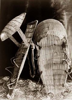 Here for your consideration is an aesthetic picture of a Chukchansi Cradle-baskets. It was created in 1924 by Edward S. Curtis.    The picture presents a fascinating image of a baby carrier.    We have created this collection of illustrations primarily to serve as a valuable educational tool. Contact curator@old-picture.com.    Image ID# 182DDAB0