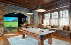 this game room is perfect for golf simulation and gaming media