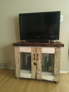 Rustic tv stand console, cabinet, handcrafted, Refashioned Eco-friendly materials antique entertainment center, buffet table, corner table on Etsy, $619.72 CAD