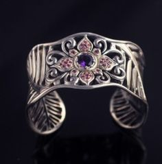 NEW DESIGN from Lydia Lerner Designs    Kelapa gemstone cuff bracelet - shown here with pink tourmaline and purple amethyst    Coconut frond detail    84.7 gm    1-1/4 inch wide  with slight variations due to wave pattern..