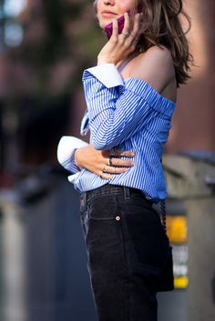 Elevate your black boyfriend jeans with an off-the-shoulder striped shirt. Don't have a blouse that drips OTS? No worries, button it loose and style it out
