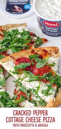 Cottage cheese and pizza are a match made in heaven! This pizza is topped with Hood Cottage Cheese with Cracked Pepper, along with Prosciutto and Arugula and makes a delicious anytime dinner or party appetizer. The cottage cheese gives the pizza an extra boost of protein and flavor and is just one of the unexpected ways you can enjoy cottage cheese! | wearenotmartha.com #cottagecheese #pizzarecipes #cottagecheeserecipes #hphood #easydinners #partyappetizers