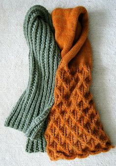 "This Easy Mistake Stitch scarf is made with Jade Sapphire's gorgeous 12-ply cashmere in color ""Green Tea"". If you know how to knit and purl you can make this scarf! Mistake Stitch creates a deep and lofty rib that looks like so much more work than it actually is.  If you're curious about the orange scarf on the right, you can find the complete instructions at this link:  Lovely Leaf Lace Scarf"