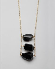 "Black Mesa Necklace    Garnett Jewelry    Three large faceted Tourmaline stones linked together to form a ladder on a gold link chain from Garnett Jewelry.    2.5"" approx. ladder length  30"" chain length"
