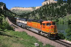 "https://flic.kr/p/NnwhXh | Fresh MAC | A Burlington Northern Santa Fe coal train recently loaded in Powder River Basin is in scenic Wendover Canyon east of Cassa, Wyoming, on July 9, 1999. A fairly new EMD SD70MAC in fresh ""Heritage II"" paint leads the eastbound train along the North Platte River."