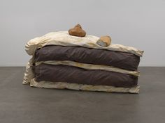 """Floor Cake  Claes Oldenburg (American, born Sweden 1929)    1962. Synthetic polymer paint and latex on canvas filled with foam rubber and cardboard boxes, 58 3/8"""" x 9' 6 1/4"""" x 58 3/8"""" (148.2 x 290.2 x 148.2 cm)."""