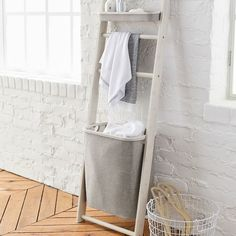 """And finally, give your laundry a designated place — yes, other than your floor — while simultaneously adding more storage with a <a href=""""https://www.pbteen.com/products/wall-leaning-storage-rack-with-hamper/"""" target=""""_blank"""" data-skimlinks-tracking='4822397'>leaning hamper rack</a>."""