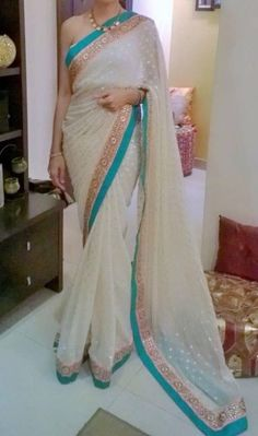 Cream Saree + Turquoise/Gold Border
