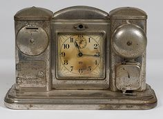 American, ca 1910, a nickel-plated alarm clock manufactured by Darche Mfg. Co. of Chicago, having a coin bank with safe on one side and an alarm on the other side;