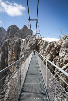 The Dachstein Suspension Bridge hangs off the side of the mountain