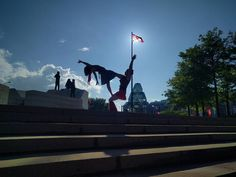 Happy belated birthday Canada! We didn't have an opportunity to acro during Canada Day because places were crazy busy. However we got the chance to wander around downtown today with @danyaxenaacroprincess and decided to show some Canadian love by doing a flag in front of a flag.   by Greg