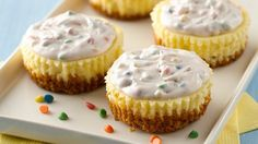 Cute little cheesecakes topped with strawberry-flavored rainbow chip frosting. Oh so yummy!