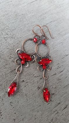 red crystal earrings in copper