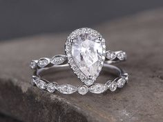 Pear shaped silver ring set/Cubic Zirconia wedding band/CZ Engagement ring/stack ring/2PC Matching Ring/Marquise band/White gold plated by kbestdesign on Etsy https://www.etsy.com/listing/521160454/pear-shaped-silver-ring-setcubic