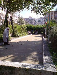 Playing bocce ball in San Giorgio a Cremano, Naples, Italy.