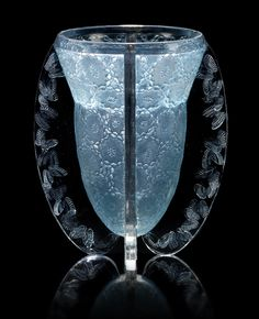 René Lalique 'Papillons' a Vase, design 1936 frosted and polished glass, heightened with blue staining 22.8cm high