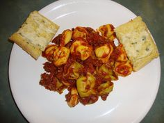 A Busy Mom's Slow Cooker Adventures: Cheese Tortellini with Italian Sausage Pasta Sauce...