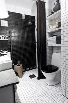 black/white/touches of wood, industrial lighting, white tiles with dark grout, linen