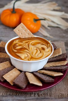 Caramel Pumpkin Pie Dip | 8 oz cream cheese, softened 2 cups powdered sugar 1 1/4 cups canned pumpkin 1/2 cup sour cream 1 1/2 tsp cinnamon 1/2 tsp nutmeg 1/2 tsp ginger 1/4 tsp cloves (optional) 1/4 - 1/2 cup caramel sauce, store bought or homemade (optional, but highly recommended) graham crackers, chocolate crackers or gingersnap cookies.