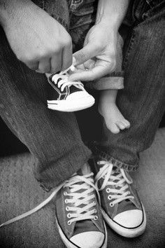 all I can think of is oh my gosh too cute ! father and son pic or a family pic in chucks ! lol