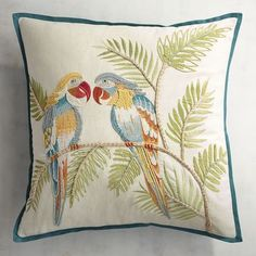 What could these two be talking about? Probably how amazing they look in their new habitat (aka your sofa), pairing natural fibers and bright colors for a touch of tropical chic.