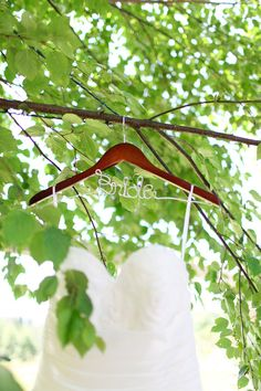 A Twin Willows Forest Wedding with a Shower of Rose Petals | Bride hanger in tree | Kaylee Eylander photography