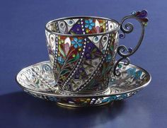 A Norwegian Plique-a-Jour Cup and Saucer. Marius Hammer, Oslo, Norway. Circa 1900. Silver gilt and enamel