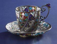 A Norwegian Plique-a-Jour Cup and Saucer. Marius Hammer, Oslo, Norway. Circa 1900. Silver gilt and enamel