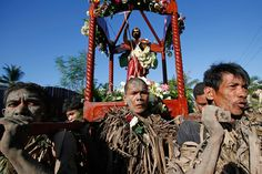 Devotees carry a statue of Saint John the Baptist while celebrating the feast day of their Catholic patron saint in the village of Bibiclat, Nueva Ecija, Philippines Water Fight, Pig Roast, Saint John, John The Baptist, Patron Saints, Demons, Philippines, Catholic, Places To Visit