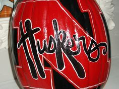 Nebraska Corn Huskers 13 Inch Plastic Pumpkin Hand Painted and Will Last For Years To Come