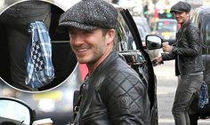 David Beckham accessorises his jeans with a scarf in the back pocket