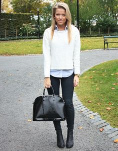 easy to recreate. black skinnies and black boots together elongate the leg. Toss a sweater over a button up