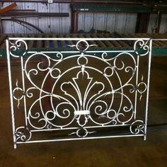 Forged Aluminum scroll work used in an exterior railing.  Customironbyjosh.com