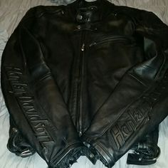 HD Leather. Make offer! PREMIUM HARLEY DAVIDSON RIDING JACKET FOR WOMEN. A must have for serious road trip bikers or enthusiasts with absolute taste in riding gear. This leather is clean. No rips, tears or scrapes. Straps and zippers adjust to your comfort level. Embossed Harley Davison arms, zippers and buttons, Silver HD branded. Vents on back, shoulders, wrists, zipper for liner, which I do not have. Quality speaks volumes. Harley Davidson  Jackets & Coats
