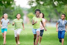 Children Playing Tag at the Park stock photo 73600725 - iStock