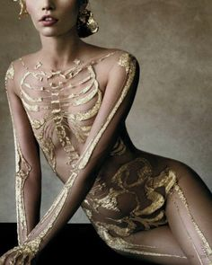 Gold skeleton nude mesh bodysuit.