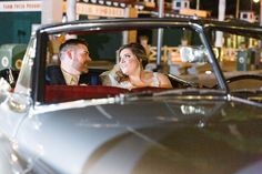 Bride & Groom arrive to Disney Fairy Tale Wedding reception on Sunset Boulevard in Hollywood Studios in a vintage car