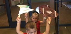 Football. Painted brown. White paint stitches. And a pennant. Colored with markers. Wear your favorite team. Go Team Parade. Pre school!