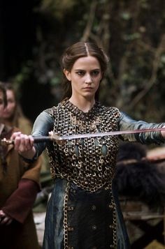 "Elowen took the sword. She raised her eyes and looked at Faine with a solemn glance. She took a deep breath.  ""I will accept the challenge."""