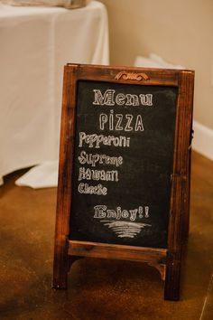 Sadie and Jonathon's 35 Guest Pizza Party Buffet Reception. Keely & Aaron Photography. See more @intimateweddings.com #weddingsigns #buffet