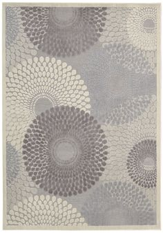 Nourison's Graphic Illusions collection, Gil04 Grey . Interlocking tri-tone spheres of cadet blue, pewter and cream hover over a strikingly understated background as they swirl together in a graphic optical illusion of smoke and mirrors. Dynamic, graphic and replete with the exquisite texture of high-loop pile construction and gorgeous hand carving, this rug represents the height of approachable modernity.